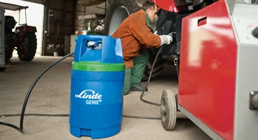 a farmer using GENIE to help weld his tractor
